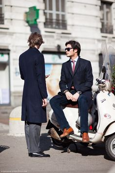Stylish men and a vespa , how can you go wrong?
