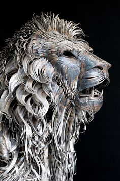 Texture: complementary  A Lion Sculpture Made Of 4,000 Pieces Of Scrap Metal   created to replicate lion's mane and body