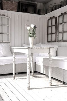 White on white, high display shelf, weathered shutters  - charming.