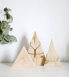 Look no further than wooden triangles to use as jewelry displays.