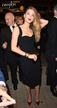 Gorgeous: Amber looked ravishing in a classic LBD paired with red satin pumps and matching lipstick