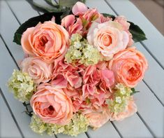 Coral salmon rose wedding bouquet by Hollysflowershoppe on Etsy, $95.00