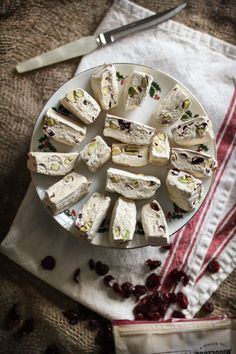 Nougat with Pistachios & Dried Cranberries: Egg whites beaten to perfection, sugar and honey heated just so, and with everything measured on a kitchen scale, I was able to conquer the nougat beast.   Adventures in Cooking {Holiday Baking}