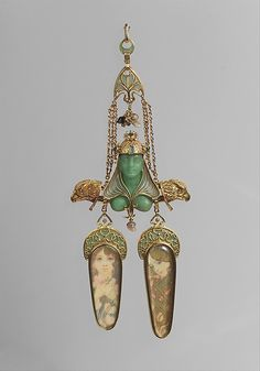 This remarkable pendant marks a high point in the three-year partnership of Fouquet, the renowned French jeweler, and Mucha, the Czech graphic artist whose work has become synonymous with Art Nouveau style. The two men collaborated from 1899 to 1901, during which time Mucha not only conceived a spectacular series of elaborate jewels executed by Fouquet's Paris atelier but also designed a sumptuous new Fouquet showroom in the rue Royale, where the interior decoration specifically harmonized…