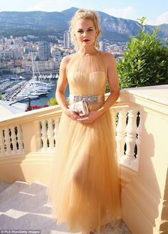 Beautiful view: On Monday, Jennifer went 1950s retro in a tulle Romona Keveza gown fastenmed with an ornate bejeweled belt at the Ministere d'Etat