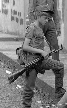 Rebel Salvadoran soldier boy combatant in Perquin, El Salvador 1990, during the Salvadoran Civil War. ERP combatants in Perquín, El Salvador in 1990