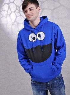 """SESAME STREET HOODIE COOKIE MONSTER FACE  SESAME STREET HOODIE COOKIE MONSTER FACE royal blue; 80% cotton, 20% polyester Oh, cookies! Dumdidumdidum … Huge Hoodie printed with the face of the Cookie Monster from Sesame Street. These hoodies, with huge prints are totally in style. Many Hollywood stars, musicians, celebrities wear these Hoodies. One of our absolute Top Sellers! Cookie Monster is a cult favorite and with the fans. Product Detail: """"SesameSstreet Hoodie""""Original from the c.."""