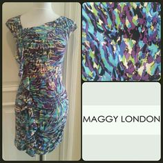 """Maggy London Geometric Print Ruched Dress Pretty Maggy London multi colored ruched sleeveless dress with ruffle going down one side. Pretty peacock colors. Blues, purples, greens, black and white. Dress is lined in black. Measures approx 32"""" around armpit area. 33"""" long. Waist 26"""" to 27"""". Hidden back zipper 20"""" long. Dress will stretch some due to 5% spandex.  Worn once or twice. EUC. Has been Dry cleaned. Purchased from Nordstroms.  Any questions please ask. Maggy London Dresses Midi"""