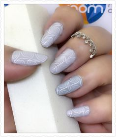 Swirl pattern on grey colored nails nailart using stamping technique. Products used - OPI Infinite Shine 'Made Your Look' and Thefaceshop 'grey'. Stamping plate - Born Pretty BP-L003