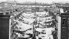 1900--Drying clothing hanging between buildings at Park Ave, 5th Avem and 107th St.