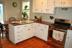 White Kitchen Interior with Wooden Countertop photo - 4