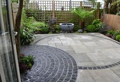 Granite Setts are great for adding a rustic edges to garden designs, as seen here in Living Spaces' design using Setts to create a circular edge.