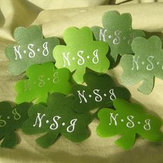 "Sure you can toss green silk rose petals at your wedding - but have you ever seen a green rose?  Shower them with petals shaped after your own heritage - with our personalized silk shamrocks!  We can imprint your names and event date in our script font or we can imprint them with your new 3 letter Monogram.  (Monogram font is bigger, so we can't print a monogram and date).  Approximately 200 shamrocks per package! Measure about 2"" each.Please allow 1 to 2 weeks for processing"