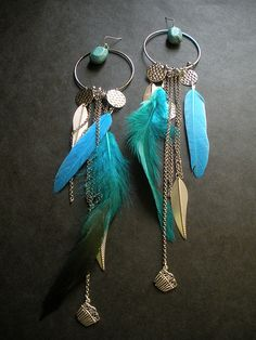 #Turquoise waters feather earrings