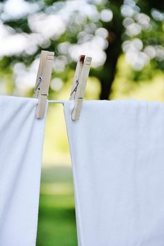 Sheets hanging on a laundry line......nothing better than the fresh smell of line dried sheets.