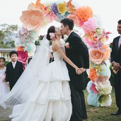 A gorgeous colourful flower power wedding. Overflowing with pretty handmade details and huge paper flowers!! Photo: History studio