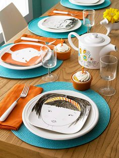 FACE PLATES... Use a porcelain paint pin....bake the pieces according the paint manufacturer's instructions to set the paint. Although they should be food safe, we recommend serving food on a separate dish. The plates would be perfect party favors for your muses.