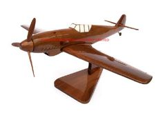 "A beautiful hand carved desktop model of the Messerschmitt. The model has been carved from solid mahogany. The model comes boxed and is simple to assemble. The wings, tail fins, stand and rota simply slot into pre-drilled holes on the body of the aircraft. No glue required. Size H 8.5"", L 15"", W 14"". Visit our website at http://www.thewoodenmodelcompany.co.uk to view the full range of our models."
