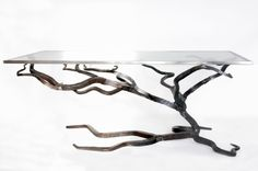 Tree Table, Glass and Metal Tree Coffee Table, Forged Sofa Table, Blacksmiths Side Table, Glass Table Top by BurnToBorn on Etsy https://www.etsy.com/listing/214783607/tree-table-glass-and-metal-tree-coffee