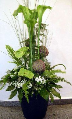 Something like this. . .tall, stylish fo vestibule or on steps. . . Use lotus pods. . .incorporate naturals