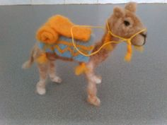 Check out this item in my Etsy shop https://www.etsy.com/listing/224652071/fiber-art-ooak-needle-felted-camel