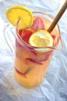 Spring Sangria with white wine, lemonade, vodka, strawberries, pineapple and more! #sangria #spring