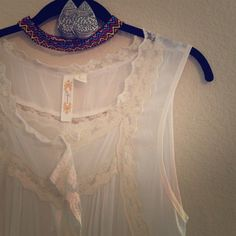 • [a diva] cream and lace top • get festival ready in this cream lace number. Rayon/polyester blend top with great lace detailing. Buttons down the front with little loops for a belt if desired. One is unraveled a bit as shown. Size large, the brand is A Diva. In great used condition. NO PAYPAL | NO TRADES A Diva Tops