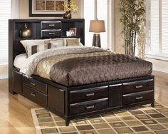 """$899.99   Ashley Kira Almost Black Queen Storage Bed B473-Q-BED  With a dark finish and exciting contemporary design, the beauty and refreshing style of the """"Kira"""" bedroom collection creates the perfect atmosphere for the bedroom of your dreams."""