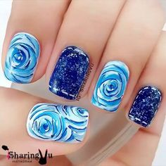 Rose and denim inspired nail art. This design looks very pretty in blue. Rose details are painted in light blue polish while the denim details are painted with a darker blue hue and white polish.