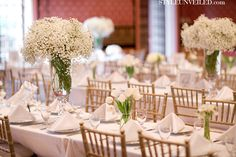 This white wedding tablescape with tulips and baby's breath just makes me swoon!