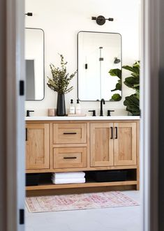 Our bathroom Reno is nearly complete, and my favorite piece is our natural wood vanity! Bathroom Renos, Bathroom Interior, Home Interior, Bathroom Ideas, Wood Bathroom Mirror, Bathroom Double Vanity, Wood Bathroom Cabinets, Remodled Bathrooms, Master Bathroom Vanity