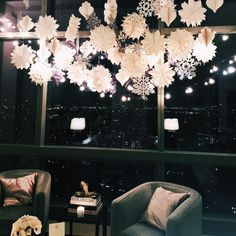 paper snowflakes + stand of lights
