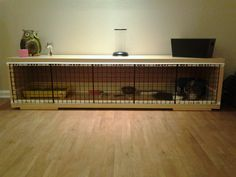 IKEA hack rabbit cage - neat idea to use as bookcase but keep the interest of the cage screen.