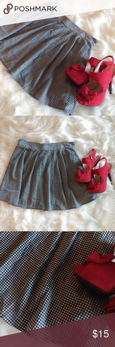 """Old Navy Gingham Circle Skater Skirt Black White Old Navy Gingham, Circle Skater Skirt. Black & White. Checkered.  Size Small.  This beautiful skirt that can mix & match with so much! ✨ Gently used but still in great condition.  Measurements are: Waist laying flat: 15"""" with an elastic waist band in the back. So there's stretch.  Length: 17"""" Bundle to save. Take a look around my closet for items for you & the whole family. (Heels not included) Old Navy Skirts Circle & Skater"""