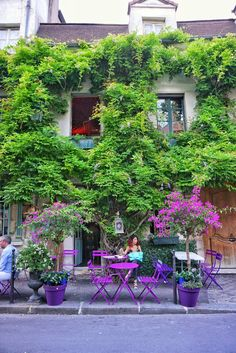 Of all the cute Parisian cafes, I doubt that any mananage to top Au Vuex Paris d'Arcole! With its winding wisteria and colourful chair ensemble, A stone's throw away from Notre Dame on Île de la Cité, the café is a perfect place to enjoy a glass of rosé on a Summer's day. Right next to this café, located behind the maroon door of Number 26, you'll find the gravestone courtyard.