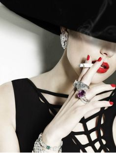 sorry..why does a lot of these great photos have to have the model smoking? Just saying...