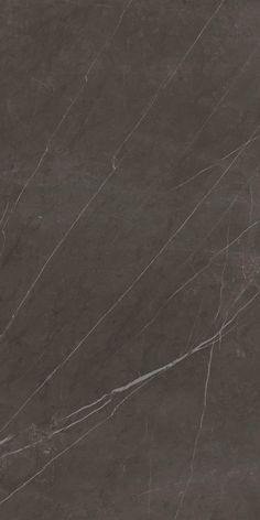 Scratches, indelible signs of the passing of time furrow the dark stone, in this case the white crystalline veins have formed over the centuries to become bold and elegant decorations. It is Pietra Grey.