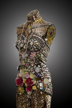 mosaics, full size mannequin, vintage jewelry, vintage china, porcelain flowers, mirrors, pearls, stained glass, spectrum glass, found objects, hand made tiles, beads,