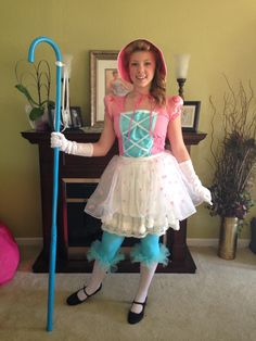 Cutest Toy Story Bo Peep ever! Found the skirt, shirt and Mary Jane heels at Goodwill. I made the overskirt, bonnet, corset, and added tulle to the bottom of Capri tights that I dyed blue. Made the staff out of a Christmas cane and a dowel rod, then painted blue.