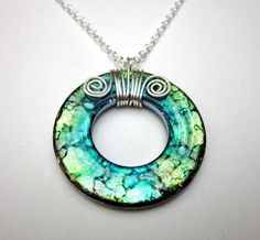 Love this necklace! It is a washer that goes through a special treatment for the colors....yep I bought one