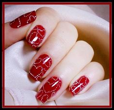 Red and white heart nail design