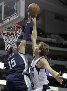 Dallas Mavericks forward Dirk Nowitzki (41) is blocked by Memphis Grizzlies guard Vince Carter (15) during the first half of play in a preseason game at American Airlines Center in Dallas on Monday, October 20, 2014. (Vernon Bryant/The Dallas Morning News)