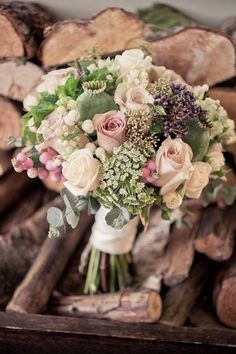 Vintage glamour in Lancashire - Autumn weddings - vintage roses together with hydrangea, poppy seed heads, astrantia, snowberry and herbs such as oregano, rosemary and dill.