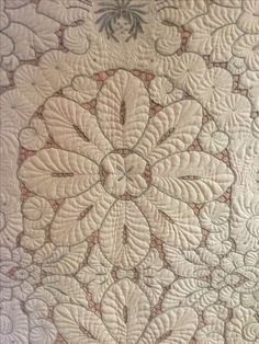 Beautiful work done by Judy Barnett on a vintage cutwork tablecloth.