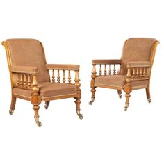 19th century oak armchairs with balustrade arm supports and upholstered in tobacco suede