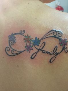 Family infinity tattoo. Each flower represents one of my siblings and 1 for my mom