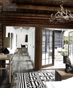Modern Rustic. Love the antler chandelier!