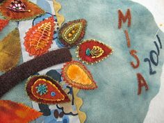 Love the stitches decorating Sue Spargo leaves