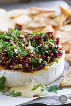 If you are looking for a show-stopping appetizer that only takes minutes to make, this Baked Brie Recipe with Sun-Dried Tomatoes is your answer! Melty cheese is topped with a mixture of sun-dried tomatoes, garlic and parsley in this addictive starter. Thanksgiving Appetizers, Holiday Appetizers, Appetizer Recipes, Baked Brie Recipes, Baked Cheese, Snacks, Dried Tomatoes, Appetisers, C'est Bon