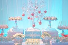 If you're longing for a snowy winter you may have to create it your self with these ideas from Sweets Indeed. Marie sent in this Winter Wonderland dessert table she designed with a pretty palette of blue, pink, and white, and added pretty snowflake details for extra pizzazz. The desserts are mostly white with a …